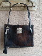 104 Cowhide Purse in Black and white concho and horse reins