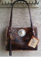 303 Cowhide Purse in Dark brindle with a  concho and horse reins