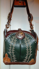 #627 Green cowboy boot purse with cream colored 7 row stitching, crystals and brow band handle. FREE LEATHER ZIPPERED BAG INSIDE.