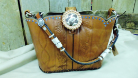 #693 Light brown with hand tooling, bucking bronc and blue crystals