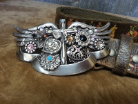 Rustic cowgirl belt with distressed cowboy motif and Swarovski cross buckle