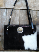 303 Cowhide Purse in Dark brindle and white with a  concho and horse reins