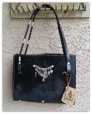302 Cowhide Purse in black with horse rein handles and trinkets