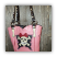 The front of this leather purse has pink crystals, silver conchos and magnetic snap closure