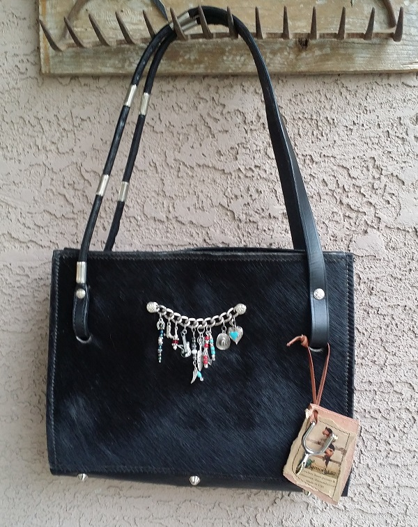 Hair on Black cowhide bag with leather handles