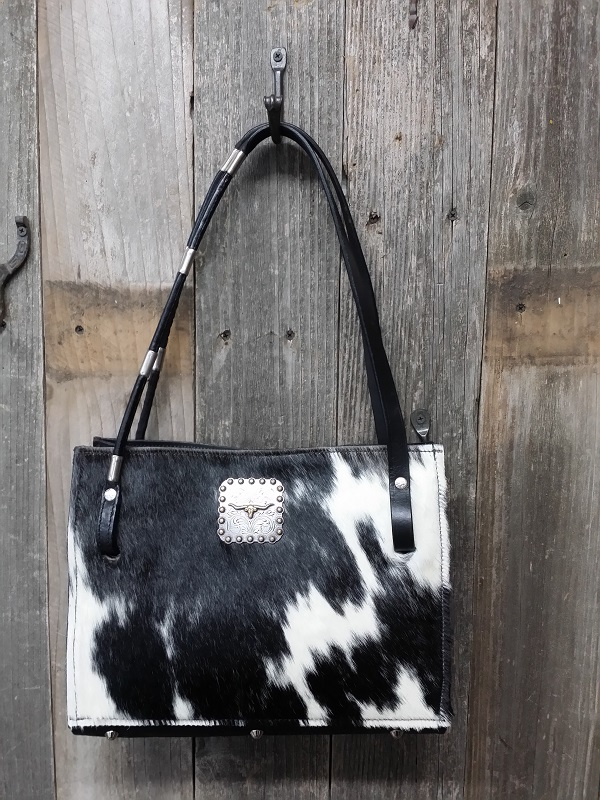 Cowhide bag with horse rein handles