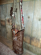 #712 brown with running horse motif handle