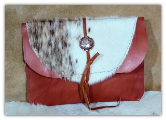 Saddle Tan leather with cowhide tablet sleeve
