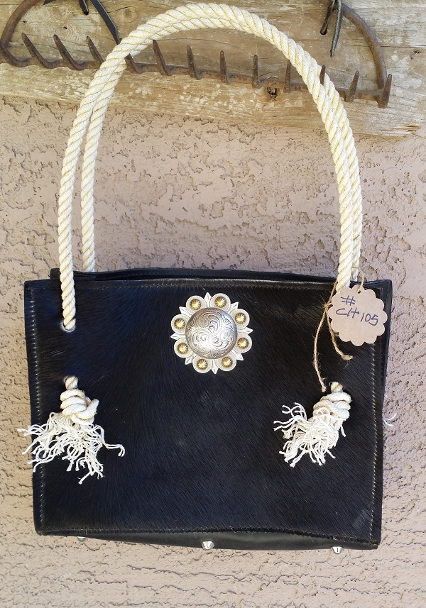 BLack hair on cowhide bag with rope handles.