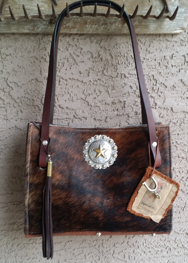 Dark Brindle cowhide bag with horse rein handles and fringe