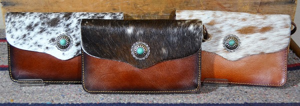 cowhide clutch with leather strap